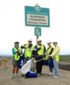 Volunteers in front of an adopt-a-highway sign